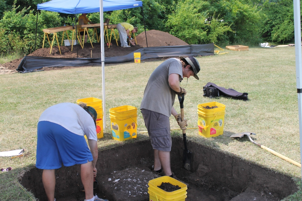 Field School students, Tee Gildemeister and Sean McKeighen, work in Unit 9. Blake Meador examines the backdirt.